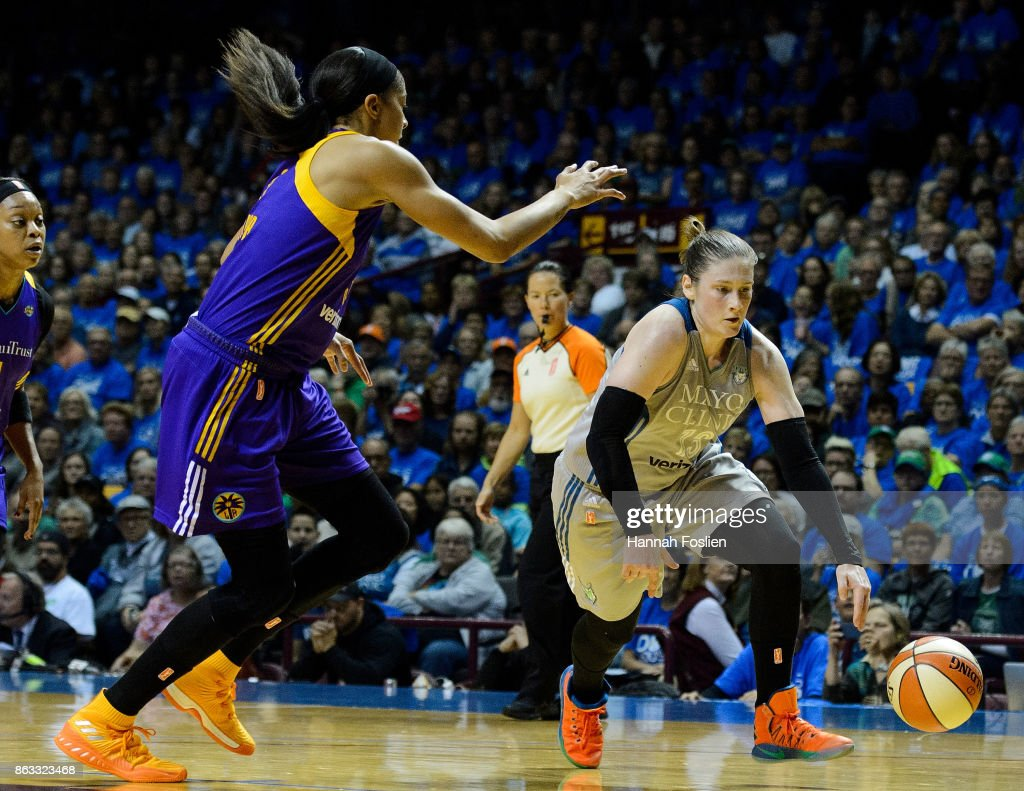 Lindsay Whalen #13 of the Minnesota Lynx dribbles the ball against the Los Angeles Sparks during the second quarter of Game Two of the WNBA Finals on September 26, 2017 at Williams in Minneapolis, Minnesota. The Lynx defeated the Sparks 70-68.
