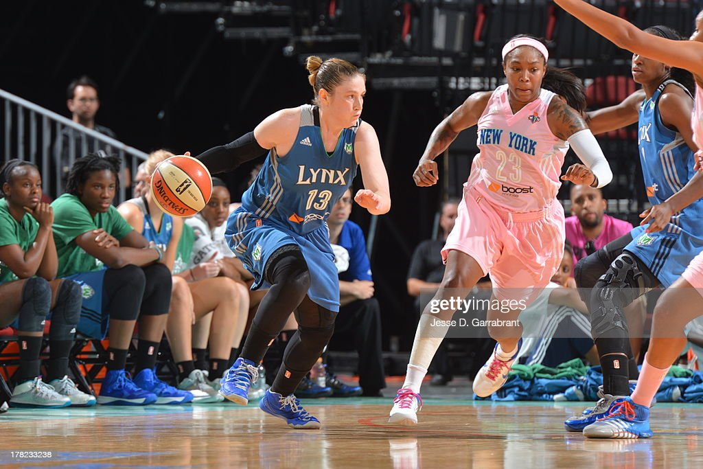 Lindsay Whalen #13 of the Minnesota Lynx drives against Cappie Pondexter #23 of the New York Liberty during the game on August 27, 2013 at Prudential Center in Newark, New Jersey.