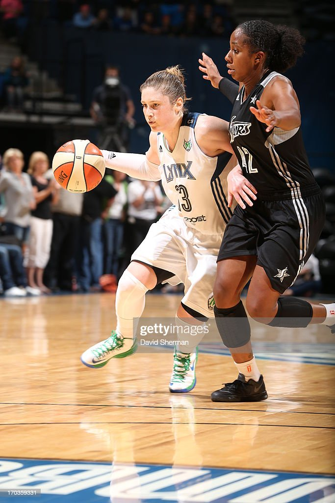 Lindsay Whalen #13 of the Minnesota Lynx drives to the basket past Shenise Johnson #42 of the San Antonio Silver Stars during the WNBA game on June 11, 2013 at Target Center in Minneapolis, Minnesota.