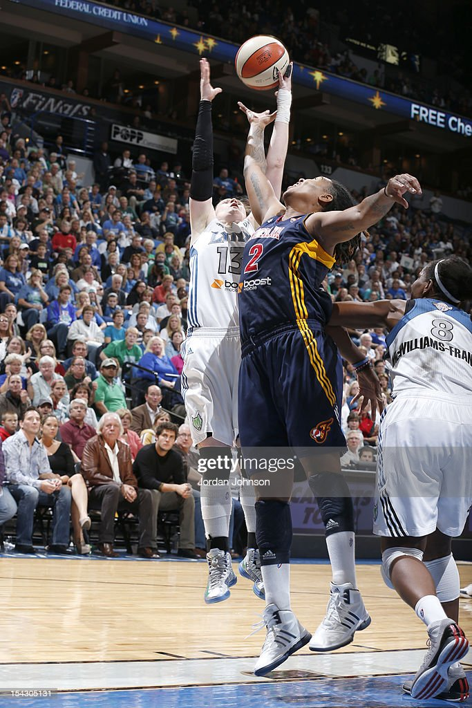 Lindsay Whalen #13 of the Minnesota Lynx fights for the rebound against Erlana Larkins #2 of the Indiana Fever during the 2012 WNBA Finals Game Two on October 17, 2012 at Target Center in Minneapolis, Minnesota.