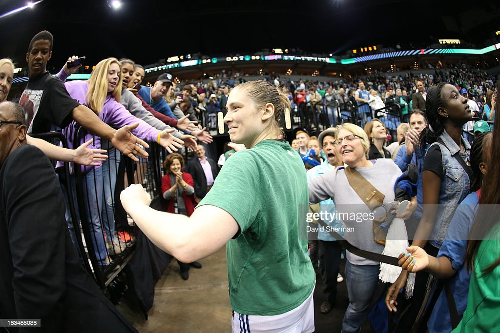 <a gi-track='captionPersonalityLinkClicked' href=/galleries/search?phrase=Lindsay+Whalen&family=editorial&specificpeople=208984 ng-click='$event.stopPropagation()'>Lindsay Whalen</a> #13 of the Minnesota Lynx gives fans high fives after the win against Atlanta Dream after Game 1 of the 2013 WNBA Finals on October 6, 2013 at Target Center in Minneapolis, Minnesota.