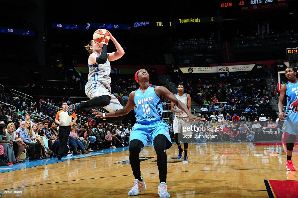Lindsay Whalen of the Minnesota Lynx goes for the layup against Matee Ajavon of the Atlanta Dream on June 10 2016 at Philips Arena in Atlanta Georgia...