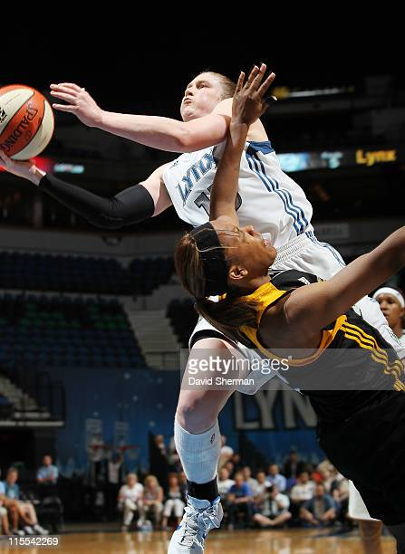 Lindsay Whalen of the Minnesota Lynx goes to the basket over Amber Holt of the Tulsa Shock during the game on June 7 2011 at the Target Center in...