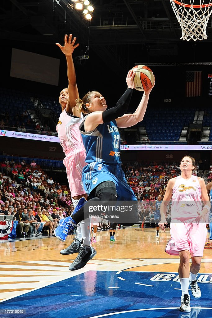 Lindsay Whalen of the Minnesota Lynx goes up for a shot against Tan White of the Connecticut Sun on August 22 2013 at the Mohegan Sun in Uncasville...
