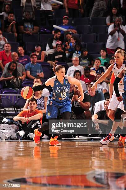 Lindsay Whalen of the Minnesota Lynx handles the ball against the Phoenix Mercury in Game 3 of the 2014 WNBA Western Conference Finals on September 2...