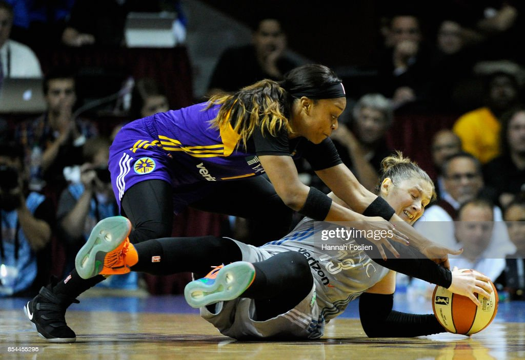 Lindsay Whalen #13 of the Minnesota Lynx holds onto the ball after falling to the court as Odyssey Sims #1 of the Los Angeles Sparks reaches in during the fourth quarter of Game Two of the WNBA Finals on September 26, 2017 at Williams in Minneapolis, Minnesota. The Lynx defeated the Sparks 70-68.