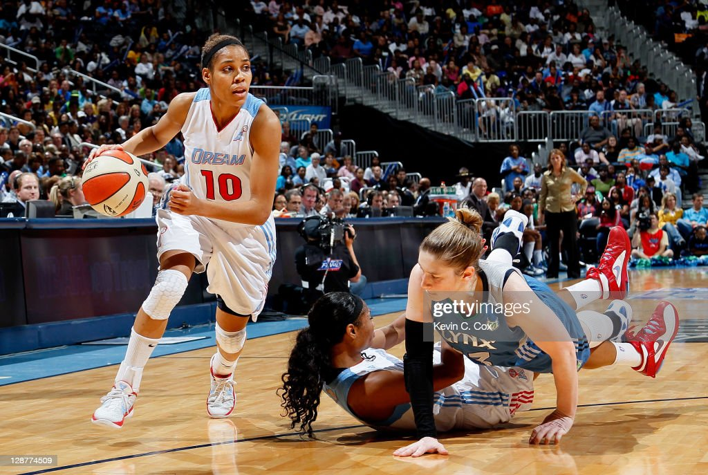 <a gi-track='captionPersonalityLinkClicked' href=/galleries/search?phrase=Lindsay+Whalen&family=editorial&specificpeople=208984 ng-click='$event.stopPropagation()'>Lindsay Whalen</a> #13 of the Minnesota Lynx knocks down <a gi-track='captionPersonalityLinkClicked' href=/galleries/search?phrase=Angel+McCoughtry&family=editorial&specificpeople=4423621 ng-click='$event.stopPropagation()'>Angel McCoughtry</a> #35 of the Atlanta Dream while defending <a gi-track='captionPersonalityLinkClicked' href=/galleries/search?phrase=Lindsey+Harding&family=editorial&specificpeople=704302 ng-click='$event.stopPropagation()'>Lindsey Harding</a> #10 in Game Three of the 2011 WNBA Finals at Philips Arena on October 7, 2011 in Atlanta, Georgia.