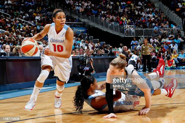 Lindsay Whalen of the Minnesota Lynx knocks down Angel McCoughtry of the Atlanta Dream while defending Lindsey Harding in Game Three of the 2011 WNBA...