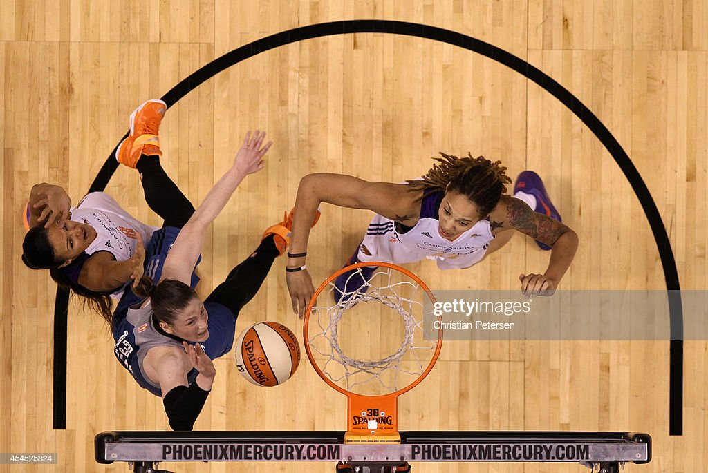 Lindsay Whalen of the Minnesota Lynx lays up a shot over Brittney Griner of the Phoenix Mercury during the first half of game three of the WNBA...