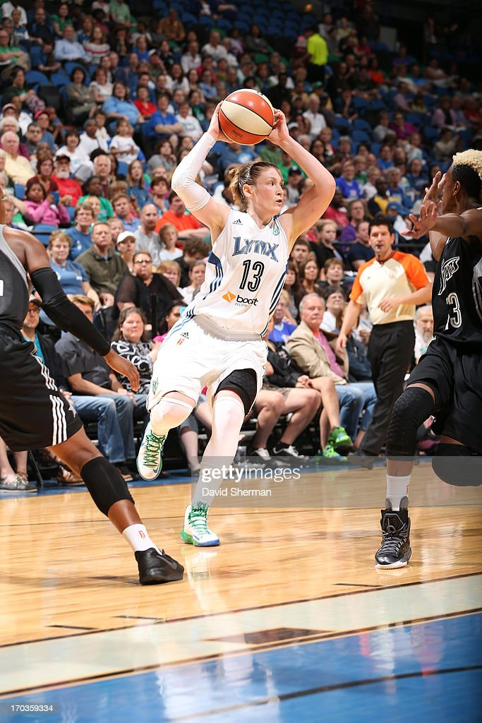 Lindsay Whalen #13 of the Minnesota Lynx looks to pass against Danielle Robinson #13 of the San Antonio Silver Stars during the WNBA game on June 11, 2013 at Target Center in Minneapolis, Minnesota.