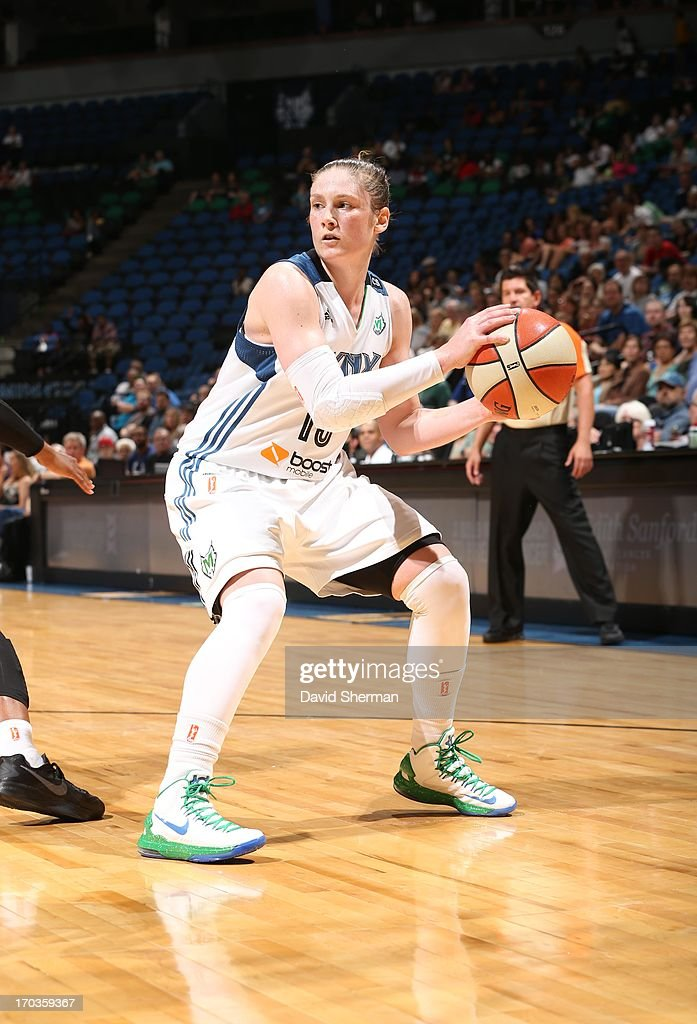 Lindsay Whalen #13 of the Minnesota Lynx looks to pass against the San Antonio Silver Stars during the WNBA game on June 11, 2013 at Target Center in Minneapolis, Minnesota.
