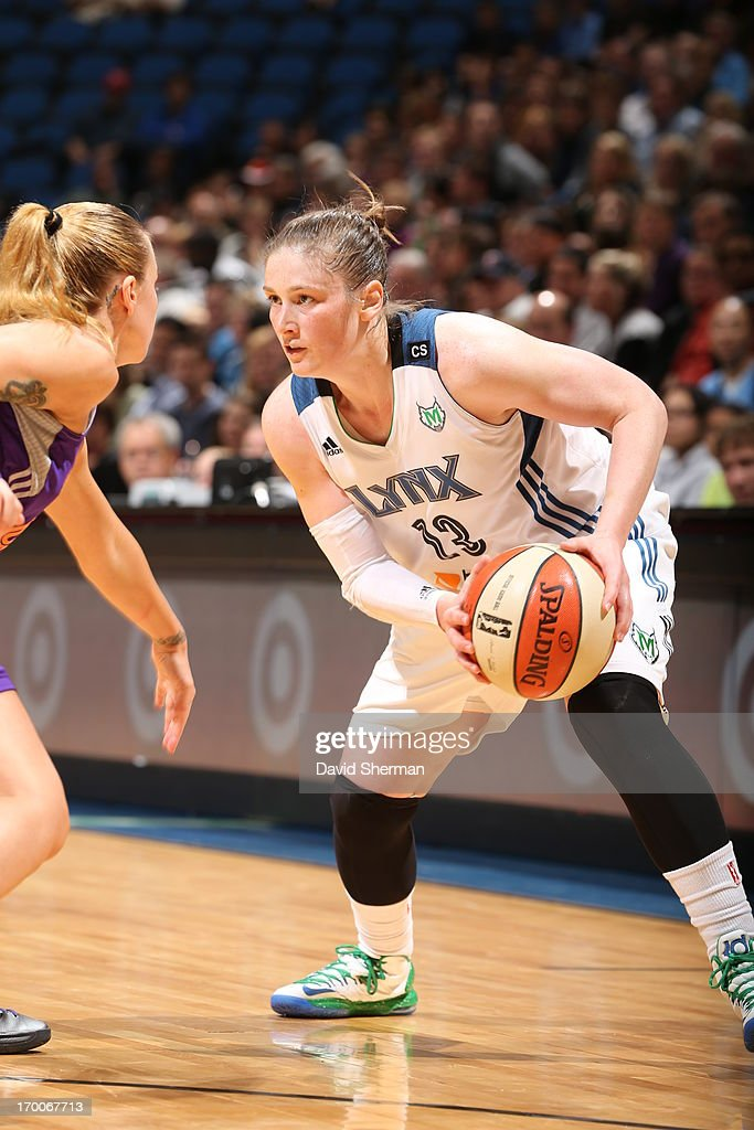 <a gi-track='captionPersonalityLinkClicked' href=/galleries/search?phrase=Lindsay+Whalen&family=editorial&specificpeople=208984 ng-click='$event.stopPropagation()'>Lindsay Whalen</a> #13 of the Minnesota Lynx makes a move against Samantha Prahalis #99 of the the Phoenix Mercury during the WNBA game on June 6, 2013 at Target Center in Minneapolis, Minnesota.