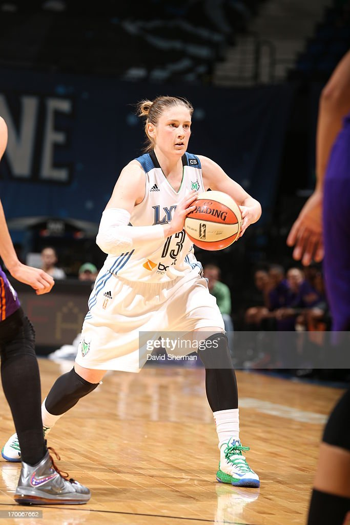 <a gi-track='captionPersonalityLinkClicked' href=/galleries/search?phrase=Lindsay+Whalen&family=editorial&specificpeople=208984 ng-click='$event.stopPropagation()'>Lindsay Whalen</a> #13 of the Minnesota Lynx passes the ball against the Phoenix Mercury during the WNBA game on June 6, 2013 at Target Center in Minneapolis, Minnesota.