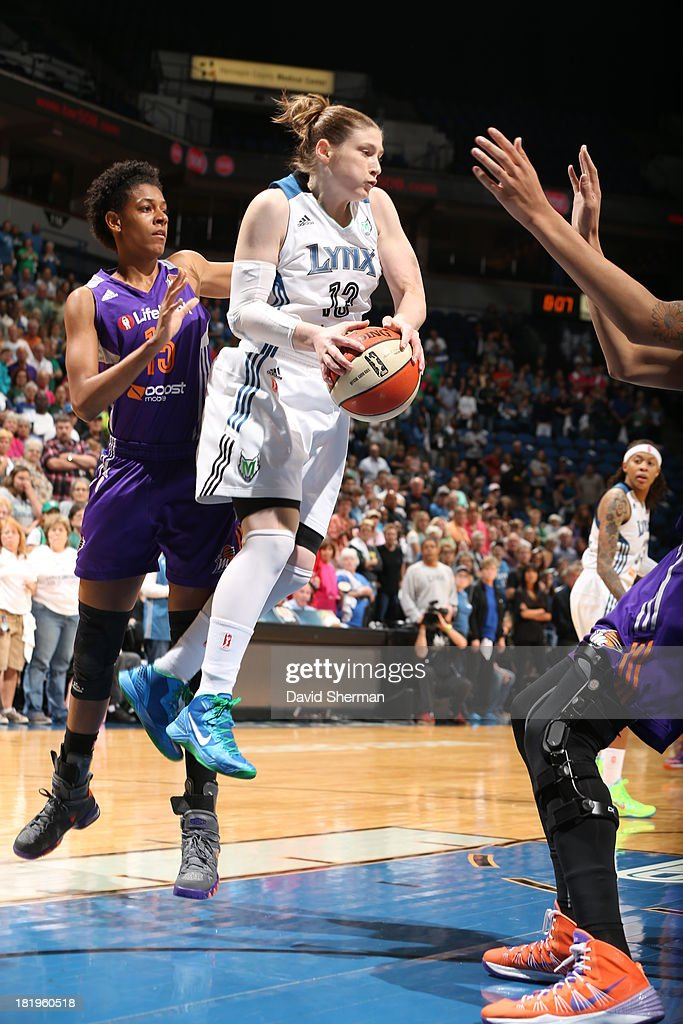 Lindsay Whalen #13 of the Minnesota Lynx rebounds the ball against against Briana Gilbreath #15 of the Phoenix Mercury during the WNBA Western Conference Finals Game 1 on September 26, 2013 at Target Center in Minneapolis, Minnesota.