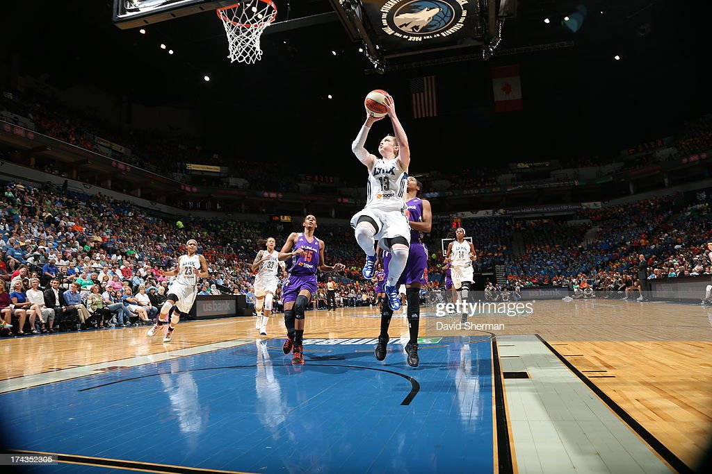 Lindsay Whalen #13 of the Minnesota Lynx shoots against Briana Gilbreath #15 and Jasmine James #10 of the Phoenix Mercury during the WNBA game on July 24, 2013 at Target Center in Minneapolis, Minnesota.
