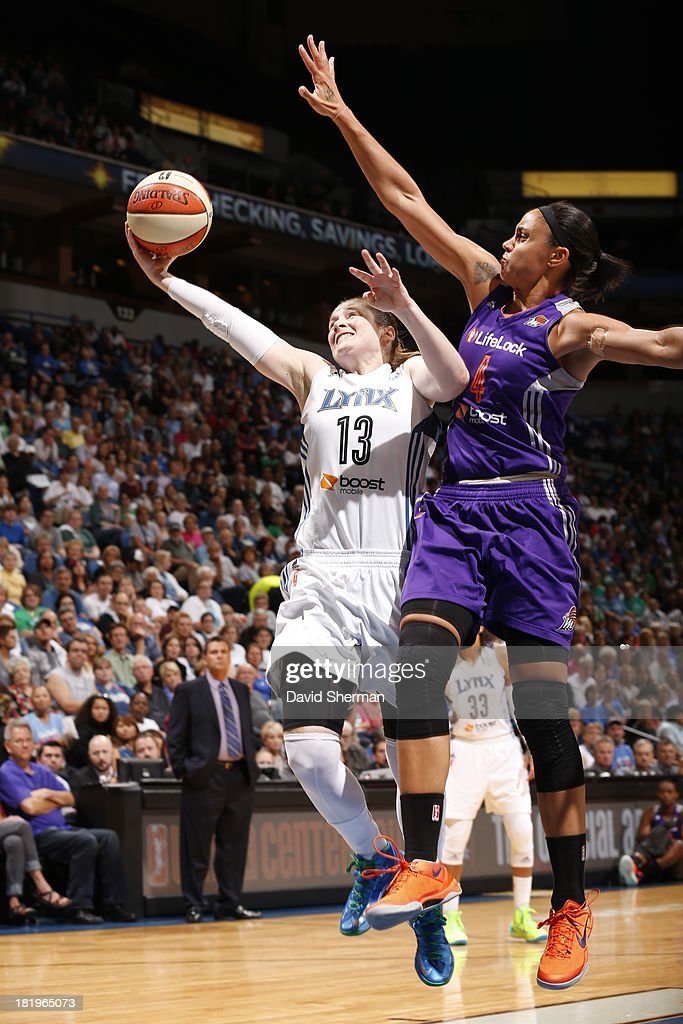 Lindsay Whalen #13 of the Minnesota Lynx shoots against Candice Dupree #4 of the Phoenix Mercury during the WNBA Western Conference Finals Game 1 on September 26, 2013 at Target Center in Minneapolis, Minnesota.