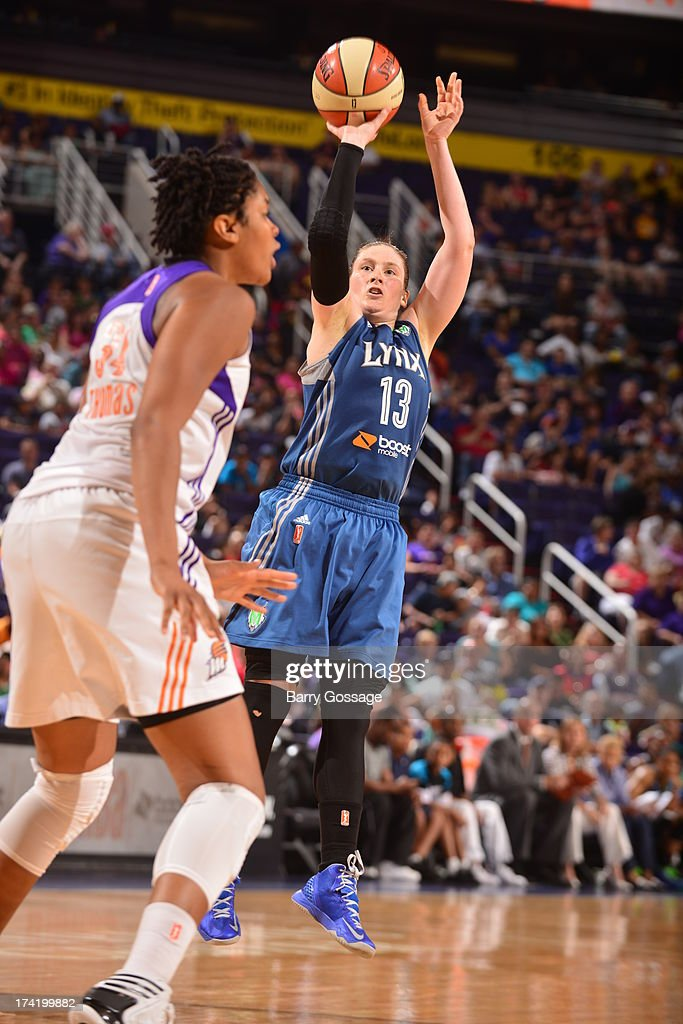 <a gi-track='captionPersonalityLinkClicked' href=/galleries/search?phrase=Lindsay+Whalen&family=editorial&specificpeople=208984 ng-click='$event.stopPropagation()'>Lindsay Whalen</a> #13 of the Minnesota Lynx shoots against Krystal Thomas #34 of the Phoenix Mercury on July 21, 2013 at U.S. Airways Center in Phoenix, Arizona.