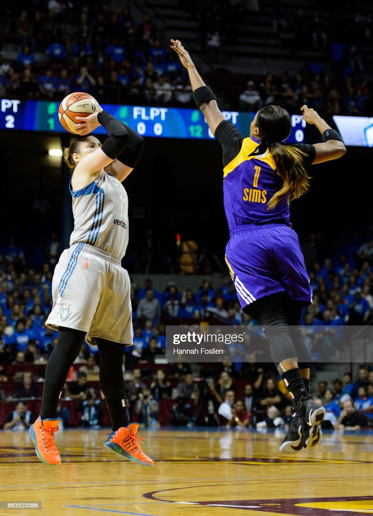 Lindsay Whalen #13 of the Minnesota Lynx shoots the ball against Odyssey Sims #1 of the Los Angeles Sparks during the first quarter of Game Two of the WNBA Finals on September 26, 2017 at Williams in Minneapolis, Minnesota. The Lynx defeated the Sparks 70-68.
