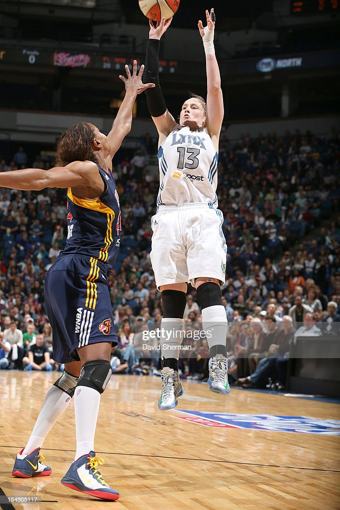 Lindsay Whalen #13 of the Minnesota Lynx shoots the ball against Tamika Catchings #24 of the Indiana Fever during the 2012 WNBA Finals Game Two on October 17, 2012 at Target Center in Minneapolis, Minnesota.