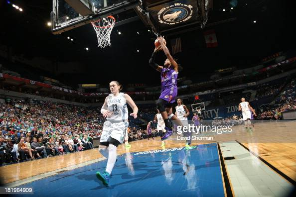 Lindsay Whalen of the Minnesota Lynx tries to stop the fast break against Alexis Hornbuckle of the Phoenix Mercury during the WNBA Western Conference...