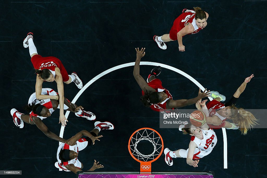 <a gi-track='captionPersonalityLinkClicked' href=/galleries/search?phrase=Lindsay+Whalen&family=editorial&specificpeople=208984 ng-click='$event.stopPropagation()'>Lindsay Whalen</a> #4 of United States and Bahar Caglar #15 of Turkey compete for a rebound in the Women's Basketball Preliminary Round match between the United States and Turkey on Day 5 of the London 2012 Olympic Games at Basketball Arena on August 1, 2012 in London, England.