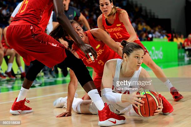 Lindsay Whalen of United States dives for the ball against Laia Palau of Spain during the Women's Gold Medal Game between United States and Spain on...