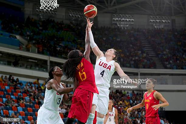Lindsay Whalen of United States goes to the basket against Astou Ndour Gueye of Spain during the Women's Gold Medal Game between United States and...