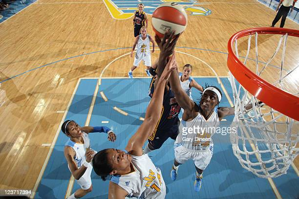 Lindsay WisdomHylton and Sylvia Fowles of the Chicago Sky battle for a rebound with Jessica Davenport of the Indiana Fever during the WNBA game on...