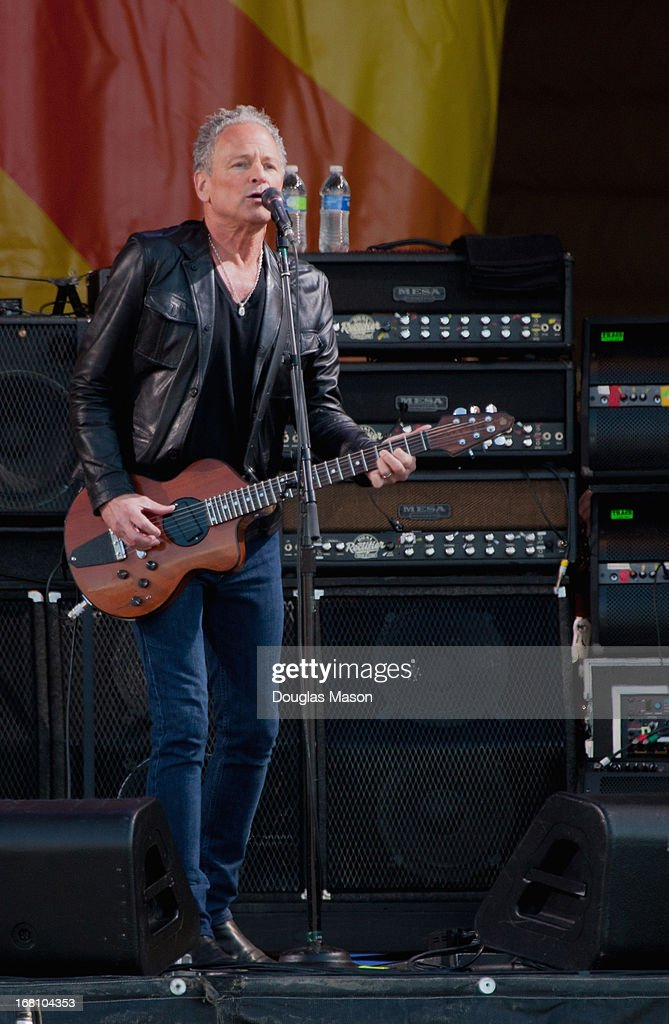 <a gi-track='captionPersonalityLinkClicked' href=/galleries/search?phrase=Lindsey+Buckingham&family=editorial&specificpeople=238836 ng-click='$event.stopPropagation()'>Lindsey Buckingham</a> of Fleetwood Mac performs during the 2013 New Orleans Jazz & Heritage Music Festival at Fair Grounds Race Course on May 4, 2013 in New Orleans, Louisiana.
