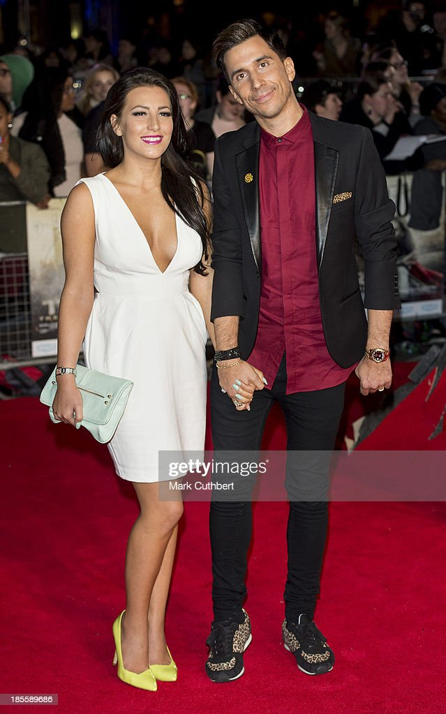 Lindsey Cole and Russell Kane attend the World Premiere of 'Thor: The Dark World' at Odeon Leicester Square on October 22, 2013 in London, England.