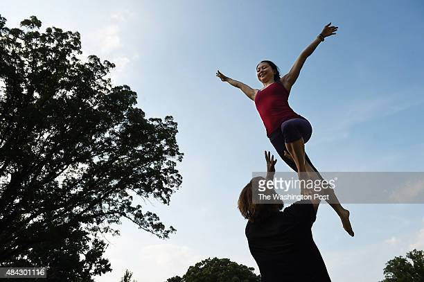 Lindsey Fong top and Josh Young bottom take part in acroyoga at Meridian Hill Park on Sunday August 09 2015 in Washington DC The park is a gathering...