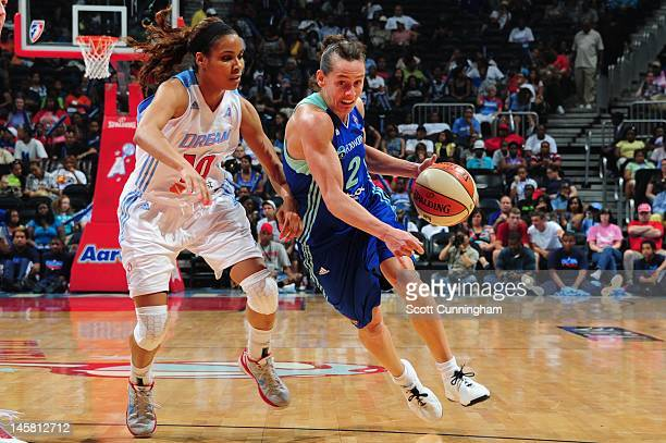 Lindsey Harding of the Atlanta Dream plays against Kelly Miller of the New York Liberty at Philips Arena on May 25 2012 in Atlanta Georgia NOTE TO...