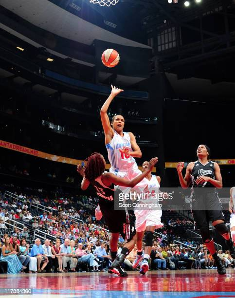 Lindsey Harding of the Atlanta Dream puts up a shot against the San Antonio Silver Stars at Philips Arena on June 26 2011 in Atlanta Georgia NOTE TO...