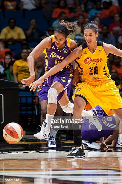 Lindsey Harding of the Los Angeles Sparks draws a foul on a drive from Nicole Powell of the Tulsa Shock during the WNBA game on July 11 2013 at the...
