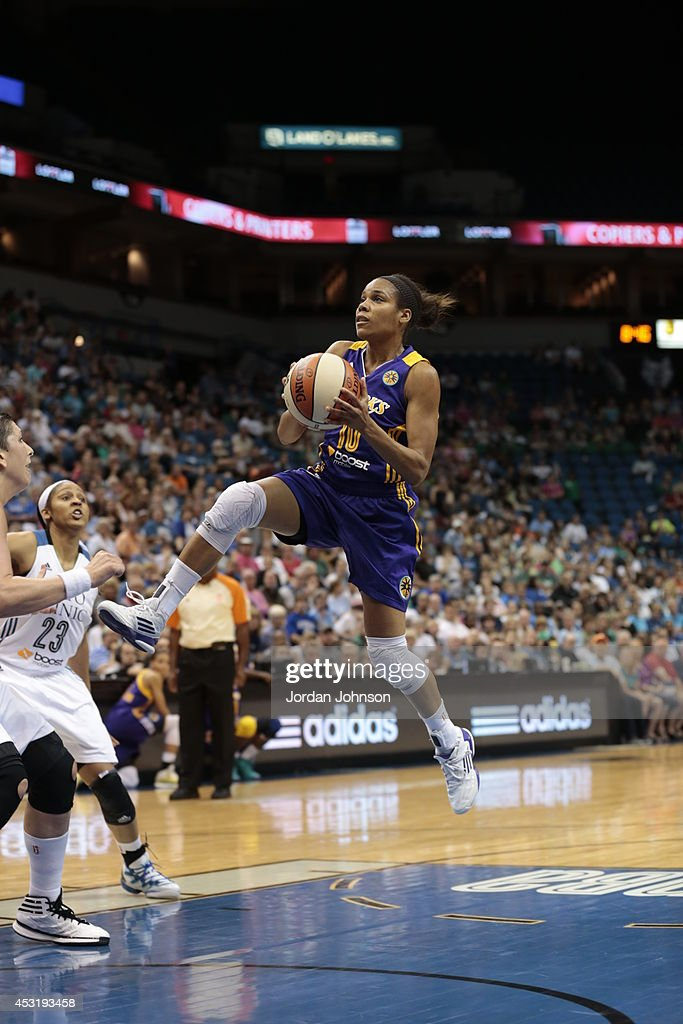 Lindsey Harding #10 of the Los Angeles Sparks drives to the basket against the Minnesota Lynx during the WNBA game on July 8, 2014 at Target Center in Minneapolis, Minnesota.
