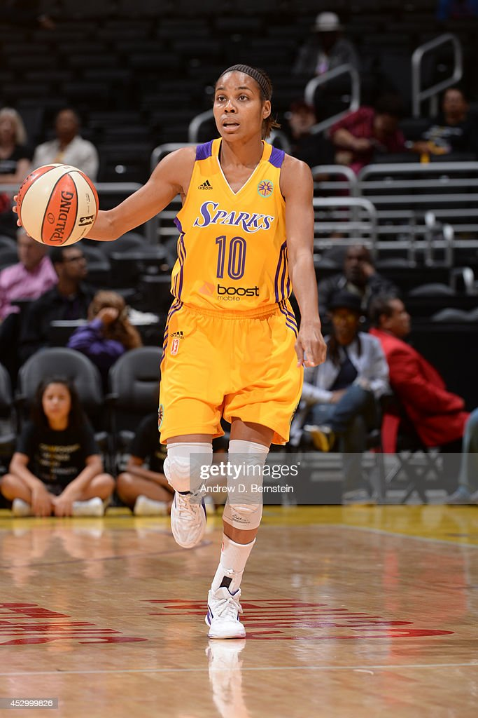 Lindsey Harding #10 of the Los Angeles Sparks moves the ball up-court against the Washington Mystics at STAPLES Center on July 17, 2014 in Los Angeles, California.