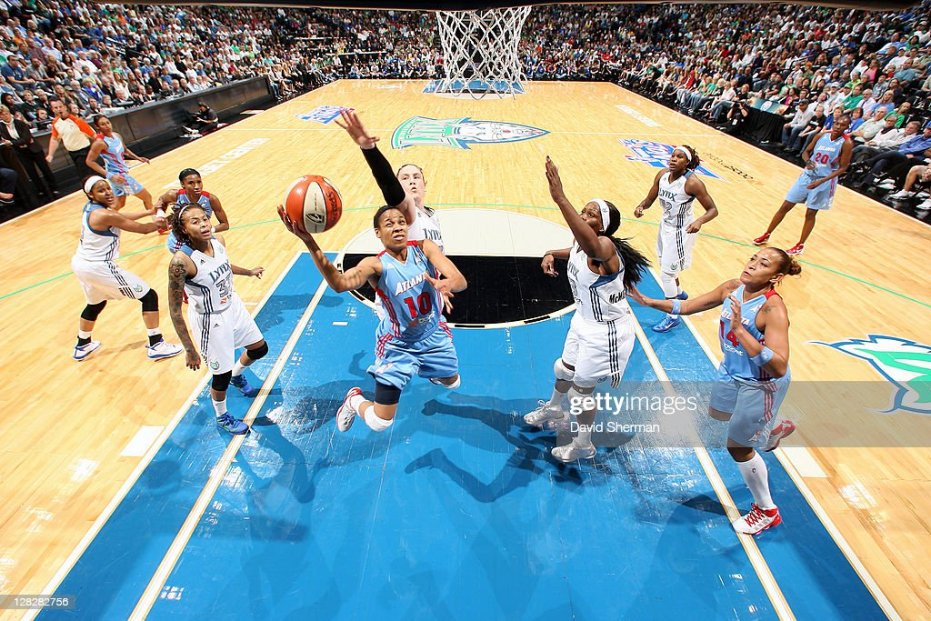 <a gi-track='captionPersonalityLinkClicked' href=/galleries/search?phrase=Lindsey+Harding&family=editorial&specificpeople=704302 ng-click='$event.stopPropagation()'>Lindsey Harding</a> #10 of the of the Atlanta Dream goes for the layup against <a gi-track='captionPersonalityLinkClicked' href=/galleries/search?phrase=Lindsay+Whalen&family=editorial&specificpeople=208984 ng-click='$event.stopPropagation()'>Lindsay Whalen</a> #13 and <a gi-track='captionPersonalityLinkClicked' href=/galleries/search?phrase=Taj+McWilliams-Franklin&family=editorial&specificpeople=213186 ng-click='$event.stopPropagation()'>Taj McWilliams-Franklin</a> #8 of the Minnesota Lynx in Game Two of the 2011 WNBA Finals on October 5, 2011 at Target Center in Minneapolis, Minnesota.
