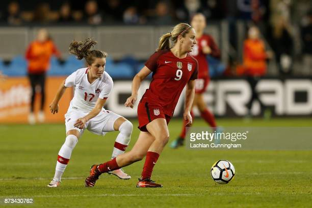Lindsey Horan of the United States evades Jessie Fleming of Canada during a friendly match at Avaya Stadium on November 12 2017 in San Jose California