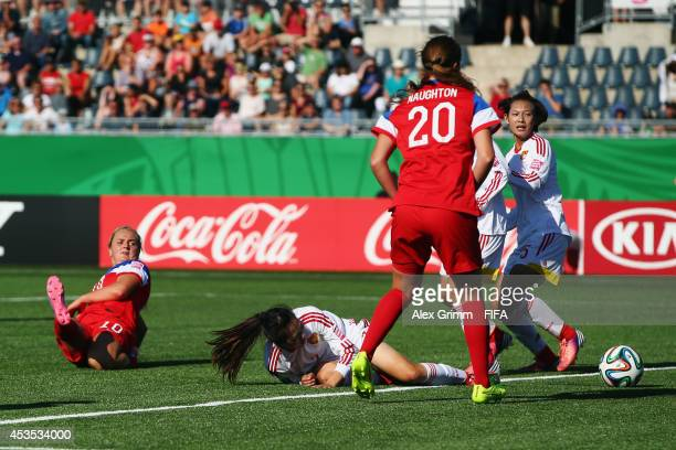 Lindsey Horan of the United States scores her team's second goal during the FIFA U20 Women's World Cup Canada 2014 group B match between the United...