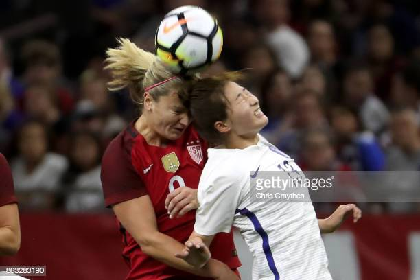 Lindsey Horan of the USA and Sunmi Ji of the Korea Republic fight for the ball at the MercedesBenz Superdome on October 19 2017 in New Orleans...