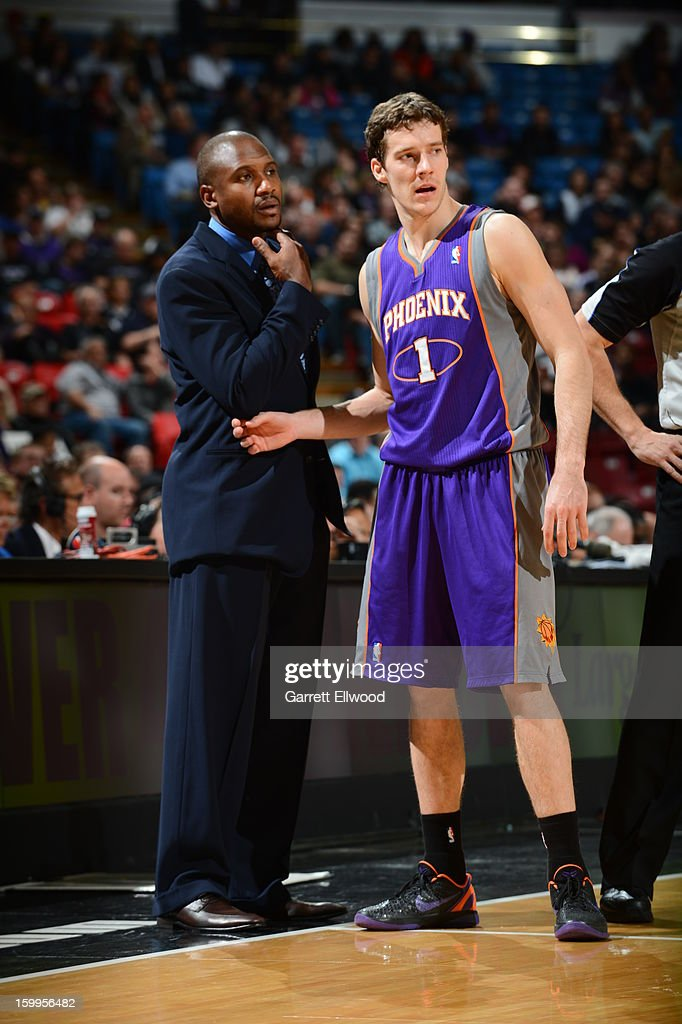 <a gi-track='captionPersonalityLinkClicked' href=/galleries/search?phrase=Lindsey+Hunter&family=editorial&specificpeople=202008 ng-click='$event.stopPropagation()'>Lindsey Hunter</a>, Head Coach of the Phoenix Suns, talks with <a gi-track='captionPersonalityLinkClicked' href=/galleries/search?phrase=Goran+Dragic&family=editorial&specificpeople=4452965 ng-click='$event.stopPropagation()'>Goran Dragic</a> #1 during a break in play against the Sacramento Kings on January 23, 2013 at Sleep Train Arena in Sacramento, California.