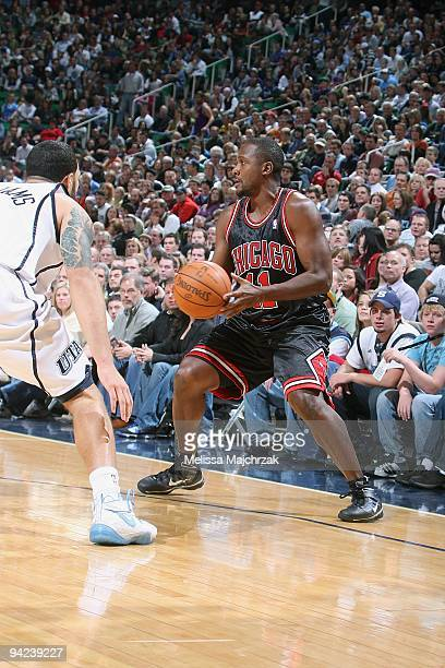 Lindsey Hunter of the Chicago Bulls drives the ball against Deron Williams of the Utah Jazz during the game on November 26 2009 at EnergySolutions...