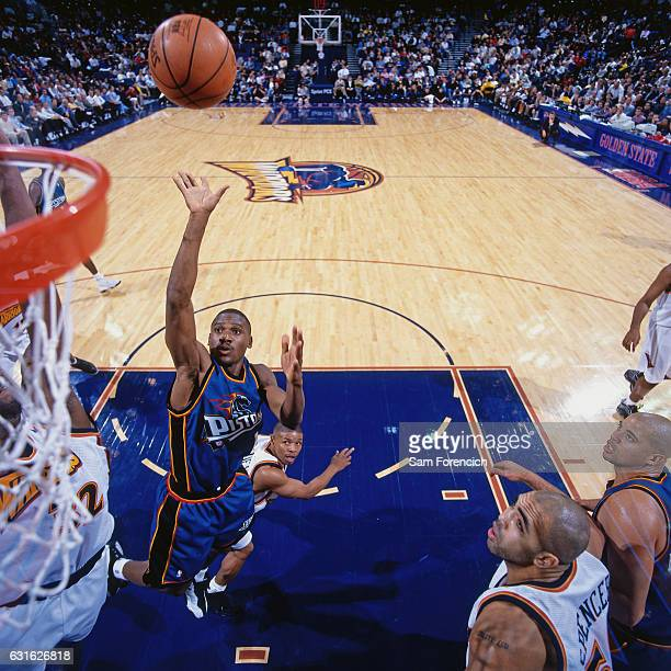 Lindsey Hunter of the Detroit Pistons shoots against the Golden State Warriors on November 12 1997 at Oracle Arena in Oakland California NOTE TO USER...