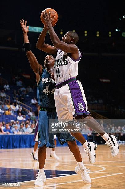 Lindsey Hunter of the Milwaukee Bucks goes up for a shot over Anthony Peeler of the Minnesota Timberwolves during the preseason game on October 22...