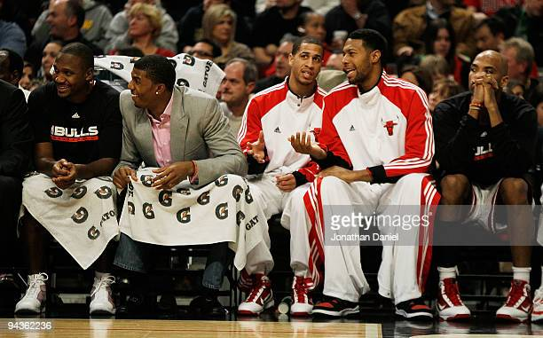 Lindsey Hunter Tyrus Thomas Jannero Pargo James Johnson and Taj Gibson of the Chicago Bulls sit on the bench during a game against the Boston Celtics...