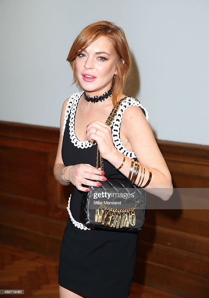 Lindsey Lohan attends the Moschino show during the London Collections: Men SS15 on June 16, 2014 in London, England.