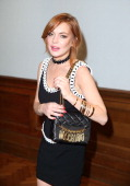 Lindsey Lohan attends the Moschino show during the London Collections Men SS15 on June 16 2014 in London England