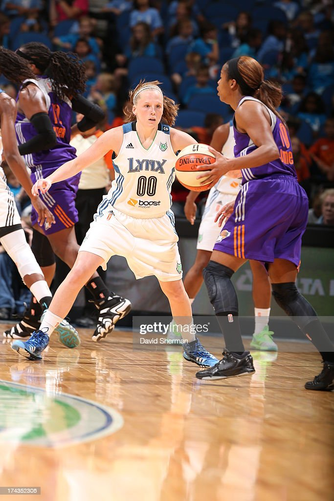 Lindsey Moore #00 of the Minnesota Lynx defends against Jasmine James #10 of the Phoenix Mercury during the WNBA game on July 24, 2013 at Target Center in Minneapolis, Minnesota.