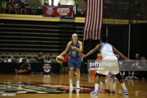Lindsey Moore of the Minnesota Lynx dribbles against Jamierra Faulkner of the Chicago Sky during the WNBA Preseason Tournament 2014 championship game...