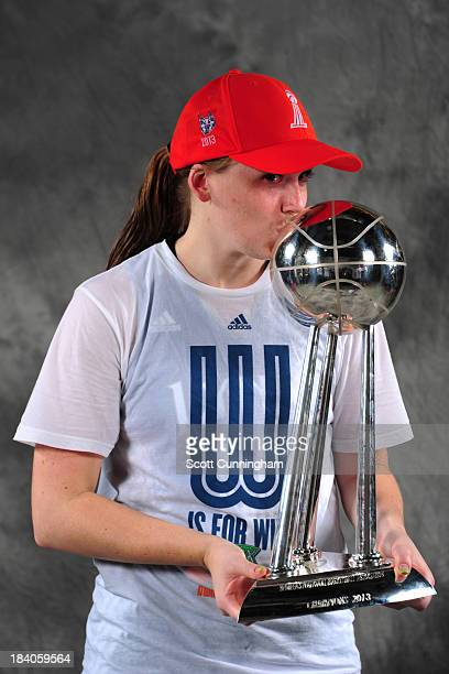 Lindsey Moore of the Minnesota Lynx poses for a picture with the trophy after winning Game 3 of the 2013 WNBA Finals at Gwinnett Arena on October 10...